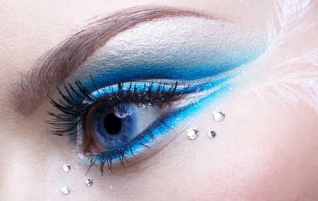 strass: woman eye zone make-up in blue and white tone