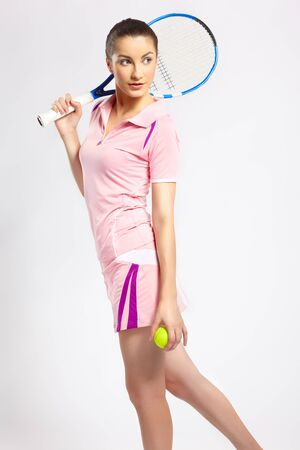 tennis player woman with tennis racket and ball photo