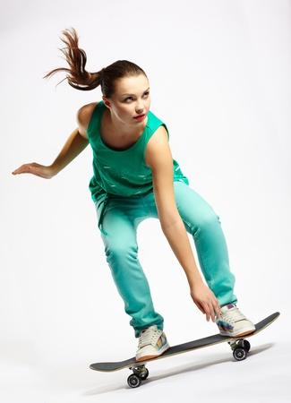 skateboarder: Skateboarder girl skating on skateboard with high speed Stock Photo