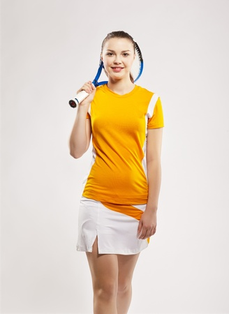 outfit: portrait of sporty girl tennis player with racket Stock Photo