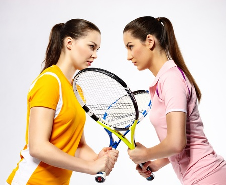 match head: portrait of two sporty girls tennis players with rackets Stock Photo