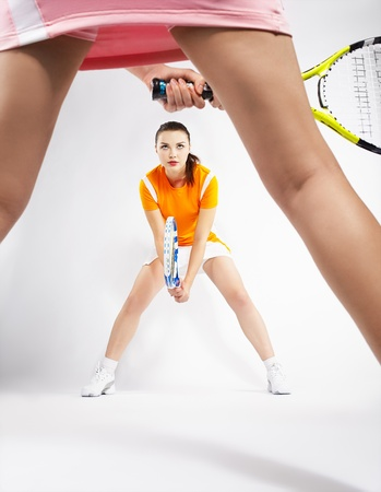 tennis skirt: portrait of two sporty girls tennis players with rackets Stock Photo