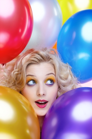 portrait of beautiful dreamy blonde girl with balloons celebrating birthday photo