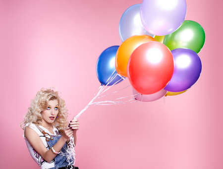 portrait of beautiful party blonde girl pulling balloons celebrating birthday Stock Photo - 8540123