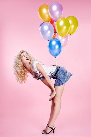portrait of beautiful blonde girl with balloons celebrating birthday photo