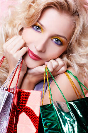 portrait of happy customer blonde girl with shopping bags photo
