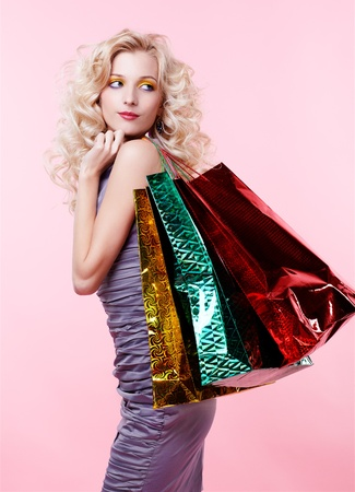shoulder bag: portrait of customer curly blonde girl carrying shopping bags
