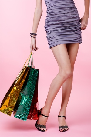 body part portrait of customer long legged girl in court shoes with shopping bags Stock Photo - 8540250