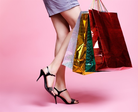 long legged: body part portrait of customer long legged girl in court shoes with shopping bags
