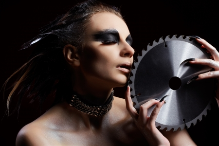 fantasy makeup: portrait of beautiful girl with bird of prey fantasy make-up with circular saw blade Stock Photo