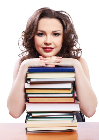 portrait of beautiful brunette student girl with books photo