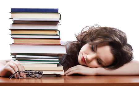 portrait of beautiful tired student girl sleeping with books Stock Photo - 8658376