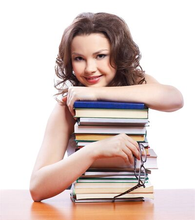 portrait of beautiful brunette student girl with books Stock Photo - 8658247