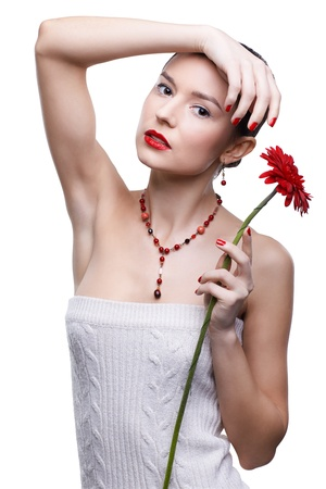 isolated portrait of beautiful brunette girl with red gerbera flower photo