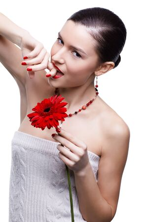isolated portrait of beautiful tempting brunette girl with red gerbera flower photo
