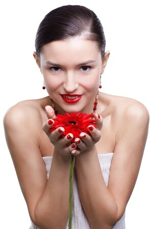 isolated portrait of beautiful happy brunette girl with red gerbera flower in hands photo