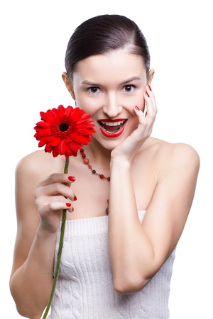 isolated portrait of beautiful happy brunette girl with red gerbera flower photo