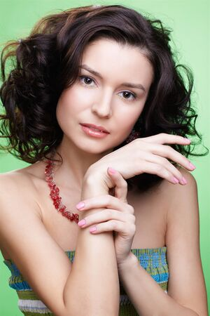 close-up portrait of beautiful curly brunette girl on green Stock Photo - 8806418