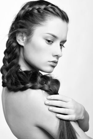 hairstyle portrait of beautiful brunette girl with creative braid hairdo Stock Photo - 8936269