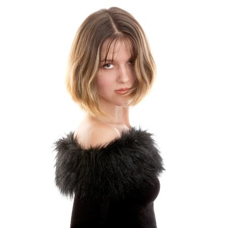 decolette: Pretty brunette woman in black dress on white background