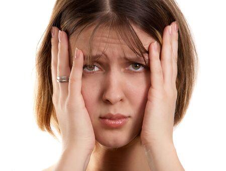 dolor de oido: Mujer joven con dolor de cabeza  Foto de archivo