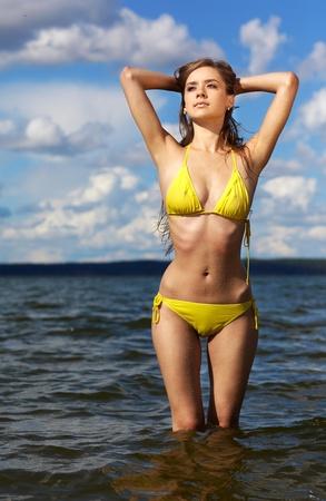 Young beautiful slavonic girl in yellow bikini posing on the beach Stock Photo - 9074801