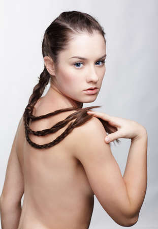 hairstyle portrait of beautiful brunette girl with creative braid hairdo Stock Photo - 9154462