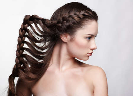 hairstyle portrait of beautiful brunette girl with creative braid hairdo Stock Photo - 9154570