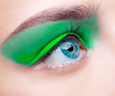 close-up portrait of beautiful girls eye-zone make-up with blue eye shadows photo