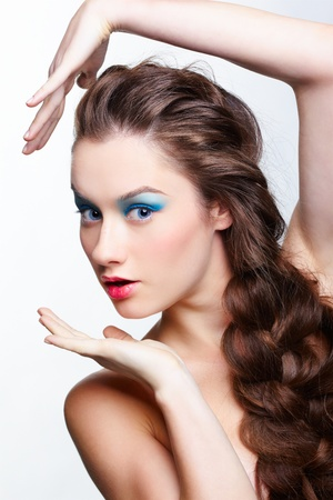 hairstyle portrait of beautiful surprised brunette girl with creative braid hairdo photo