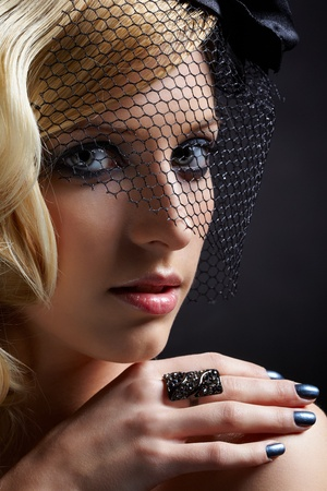 glamour portrait of beautiful blonde retro girl in veil on dark Stock Photo - 9154670