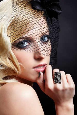 glamour portrait of beautiful blonde retro girl in veil on dark Stock Photo - 9154668