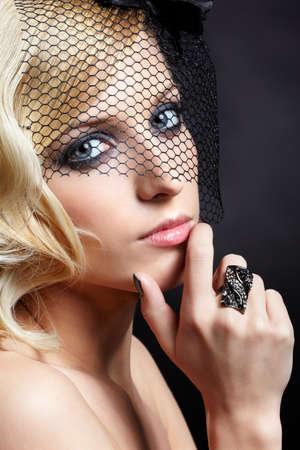 glamour portrait of beautiful blonde retro girl in veil on dark Stock Photo - 9154674