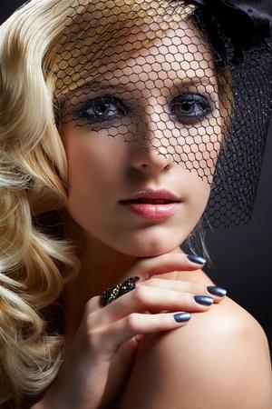 glamour portrait of beautiful blonde retro girl in veil on dark Stock Photo - 9154675