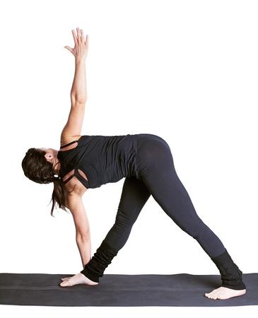 trikonasana: full-length portrait of beautiful woman working out yoga excercise utthita trikonasana on fitness mat