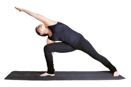 full-length portrait of beautiful woman working out yoga excercise side angle pose utthita parshvakonasana on fitness mat Stock Photo - 9191099
