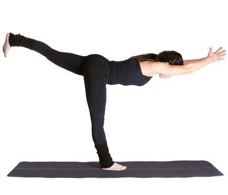 excercise: full-length portrait of beautiful woman working out yoga excercise Virabhadrasana III on fitness mat Stock Photo