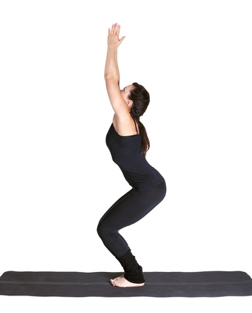 full-length portrait of beautiful woman working out yoga excercise utkatasana on fitness mat Stock Photo - 9191043