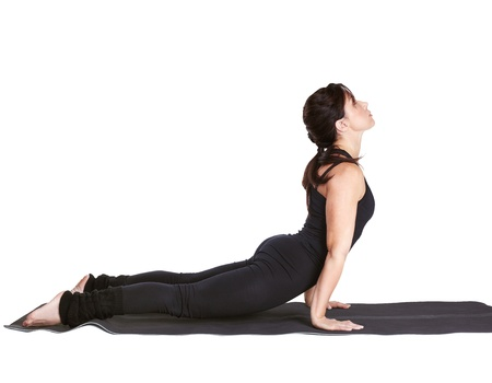 excercise: full-length portrait of beautiful woman working out yoga excercise urdhva mukha shvanasana (cobra pose) on fitness mat
