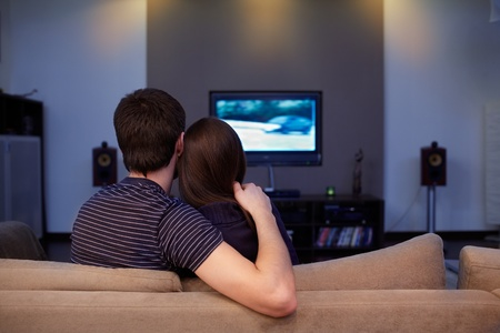 family movies: Young couple waching  movie on tv Stock Photo