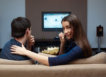 Young couple waching  movie on tv Stock Photo - 9253864