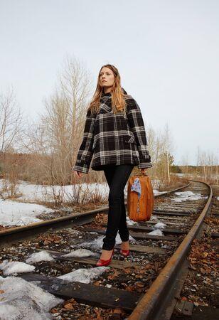 railroad tie: Girl walking along old railroad Stock Photo