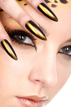 close-up portrait of beautiful young european model in cat make-up and bodyart Stock Photo - 9340196