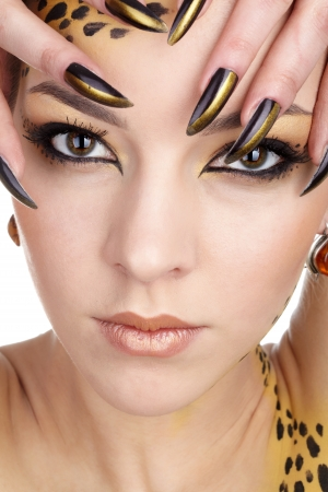 close-up portrait of beautiful young european model in cat make-up and bodyart photo