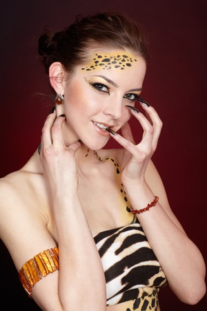 portrait of girll in cat make-up and bodyart photo
