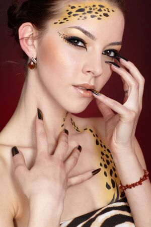 portrait of girll in cat make-up and bodyart Stock Photo - 9340183