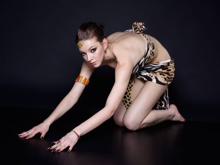 cat stretching: portrait of girll in cat make-up and bodyart