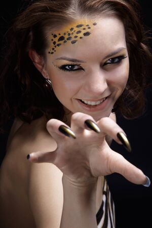 portrait of girll in cat make-up and bodyart Stock Photo - 9340189