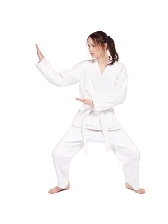 kata: full-length isolated portrait of beautiful martial arts girl in kimono excercising karate kata Stock Photo