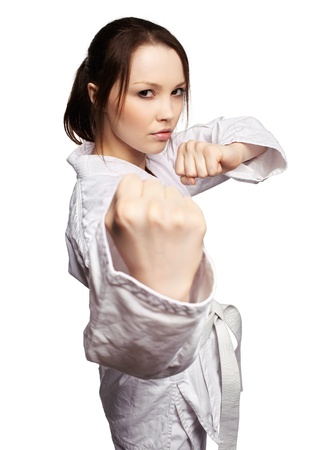 girl punch: isolated portrait of beautiful martial arts girl in kimono excercising karate kata